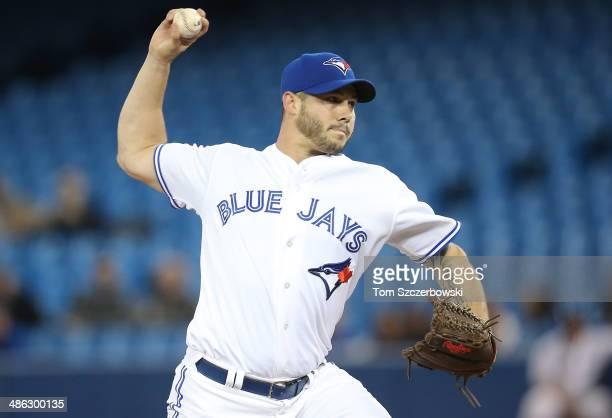 Dustin McGowan of the Toronto Blue Jays delivers a pitch in the second inning during MLB game action against the Baltimore Orioles on April 23 2014...