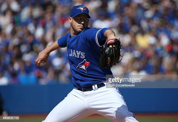 Dustin McGowan of the Toronto Blue Jays delivers a pitch in the eighth inning during MLB game action against the Oakland Athletics on May 25 2014 at...