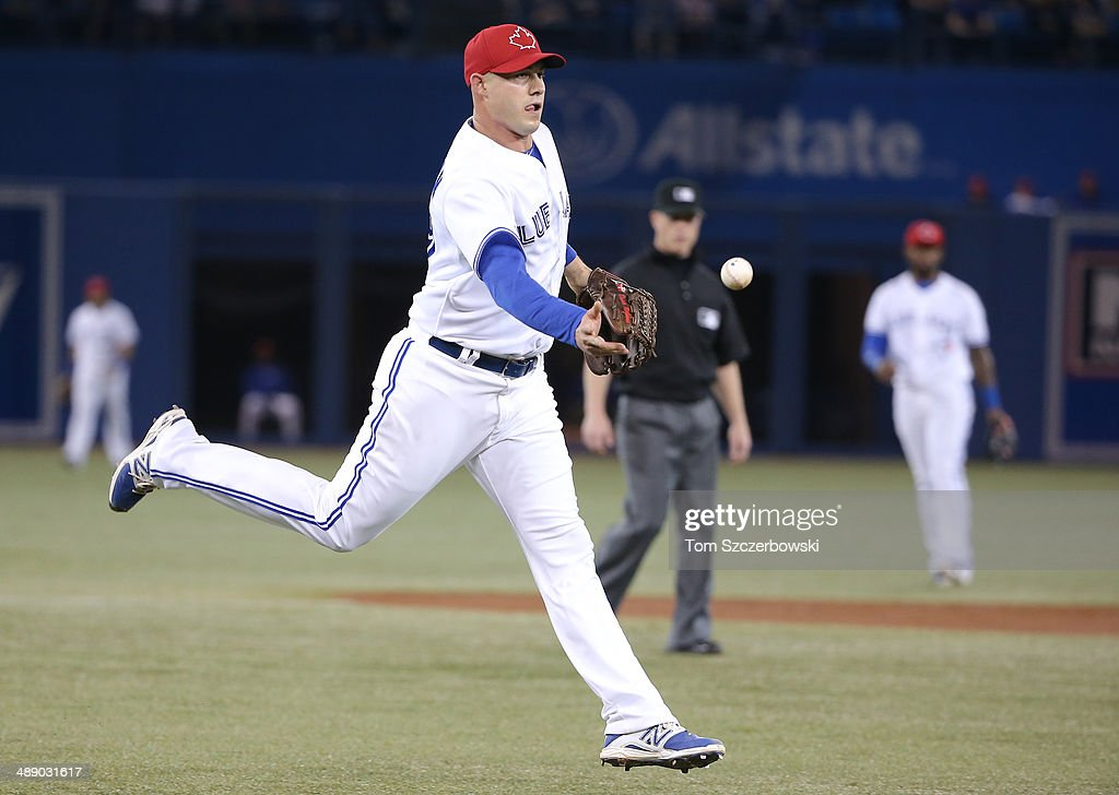 Dustin McGowan #29 of the Toronto Blue Jays flips the ball to first base to get the final out of the second inning during MLB game action against the Los Angeles Angels of Anaheim on May 9, 2014 at Rogers Centre in Toronto, Ontario, Canada.