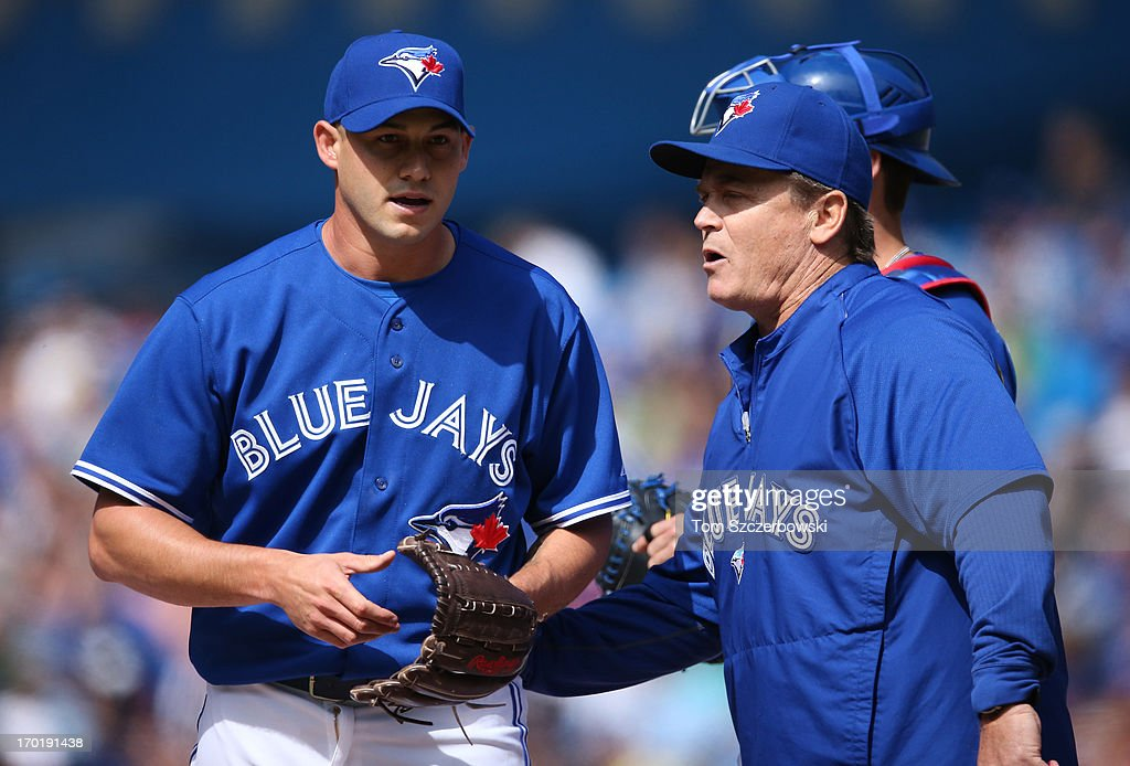 Dustin McGowan #29 of the Toronto Blue Jays is relieved by manager John Gibbons #5 in the tenth inning during MLB game action against the Texas Rangers on June 8, 2013 at Rogers Centre in Toronto, Ontario, Canada.