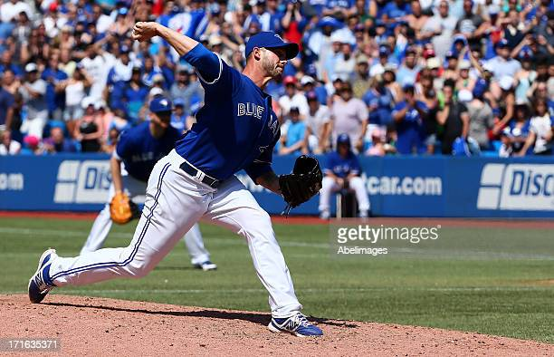 Dustin McGowan of the Toronto Blue Jays pitches against the Baltimore Orioles in the first inning at the Rogers Centre June 23 2013 in Toronto...
