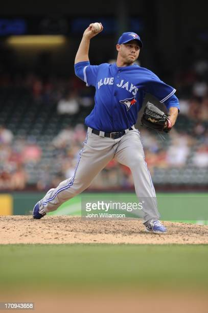 Dustin McGowan of the Toronto Blue Jays pitches against the Texas Rangers at Rangers Ballpark on June 15 2013 in Arlington Texas The Toronto Blue...