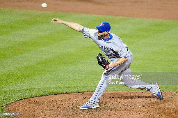 Dustin McGowan of the Toronto Blue Jays pitches in the ninth inning against the Baltimore Orioles at Oriole Park at Camden Yards on June 13 2014 in...