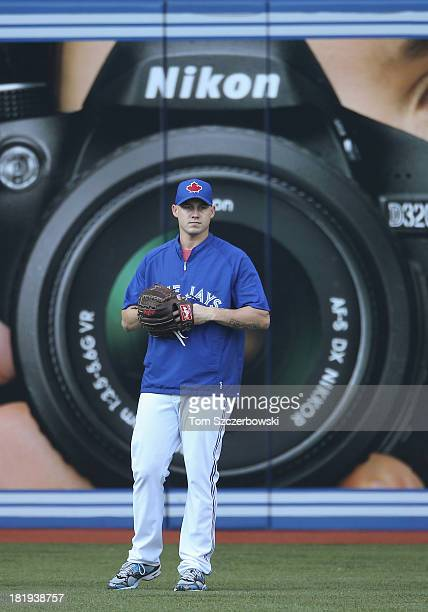 Dustin McGowan of the Toronto Blue Jays warms up during batting practice before MLB game action against the New York Yankees on September 19 2013 at...