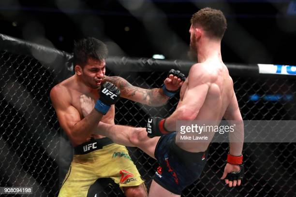 Dustin Ortiz kicks Alexandre Pantoja in their Flyweight fight during UFC 220 at TD Garden on January 20 2018 in Boston Massachusetts