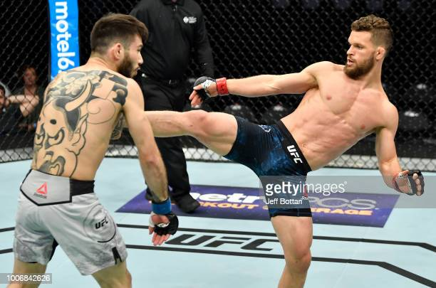 Dustin Ortiz kicks Matheus Nicolau of Brazil in their flyweight bout during the UFC Fight Night event at Scotiabank Saddledome on July 28 2018 in...