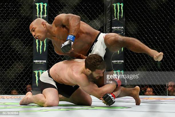 Dustin Ortiz of the United States goes to takedown Wilson Reis of Brazil in their flyweight bout during the UFC Fight Night event at the Prudential...