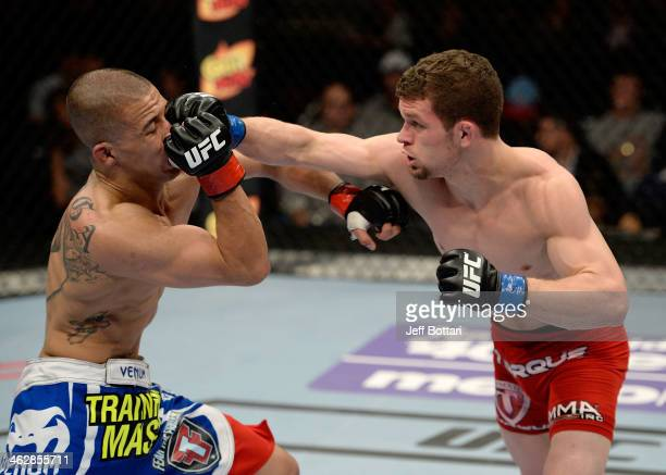 Dustin Ortiz punches John Moraga in their flyweight fight during the UFC Fight Night event inside The Arena at Gwinnett Center on January 15 2014 in...