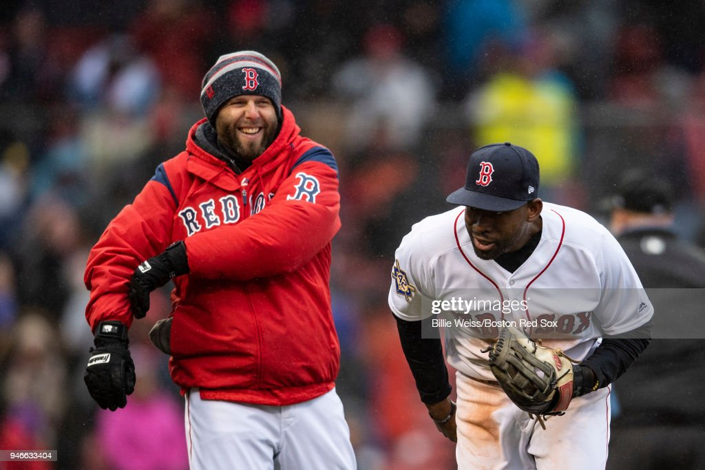 Dustin Pedroia #15 and Jackie Bradley Jr. #18 of the Boston Red Sox celebrate a victory against the Baltimore Orioles on April 15, 2018 at Fenway Park in Boston, Massachusetts.