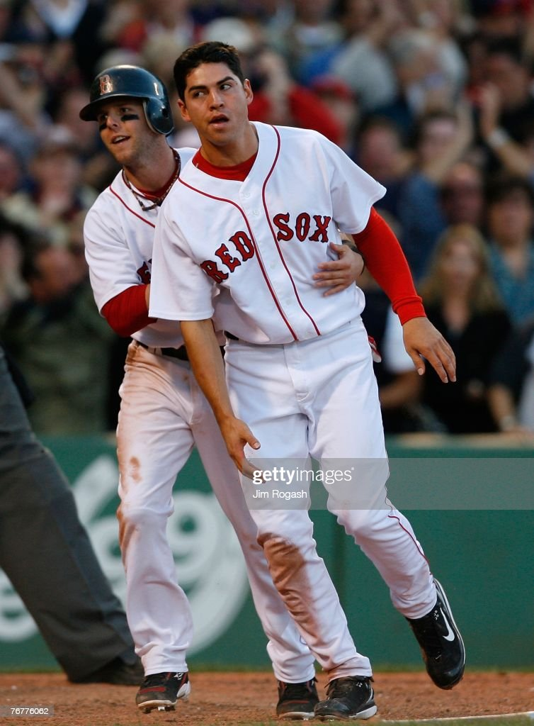 Dustin Pedroia #15 and Jacoby Ellsbury #46 of the Boston Red Sox react after scoring in the sixth inning during a game against the New York Yankees on September 15, 2007 at Fenway Park in Boston, Massachusetts.