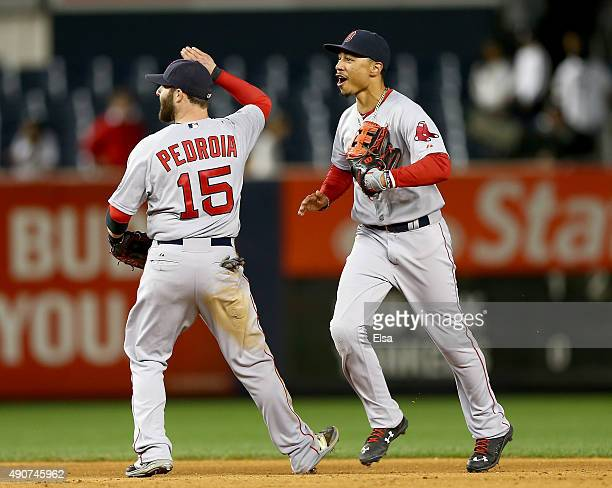 Dustin Pedroia and Mookie Betts of the Boston Red Sox celebrate the win over the New York Yankees on September 30 2015 at Yankee Stadium in the Bronx...