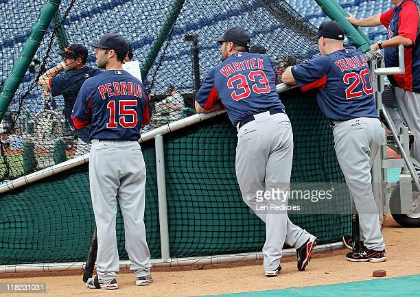Dustin Pedroia Jason Varitek and Kevin Youkilis of the Boston Red Sox look on during batting practice against the Philadelphia Phillies at Citizens...