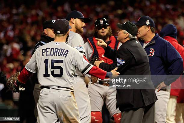 Dustin Pedroia of the Boston Red Sox and others react after Allen Craig of the St Louis Cardinals scored the winning run in the ninth inning of Game...