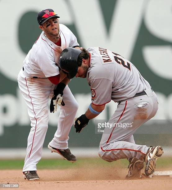 Dustin Pedroia of the Boston Red Sox and Ryan Klesko of the San Francisco Giants collide at second on June 17 2007 at Fenway Park in Boston...