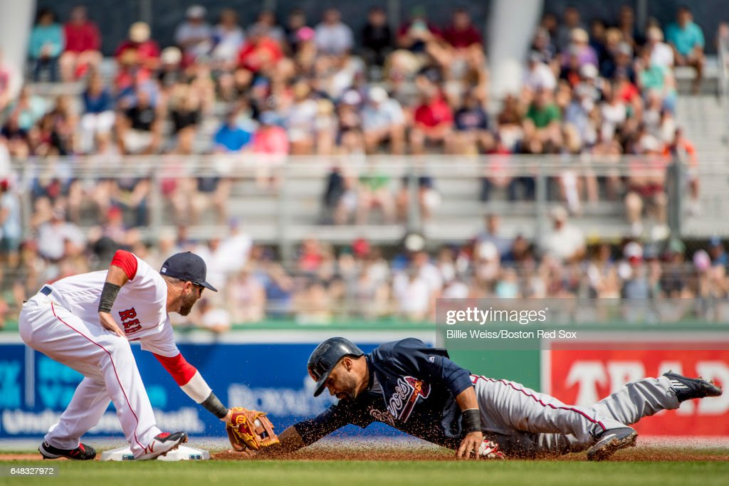 Dustin Pedroia #15 of the Boston Red Sox applies a tag during the first inning of a Spring Training game against the Atlanta Braves on March 5, 2017 at Fenway South in Fort Myers, Florida .