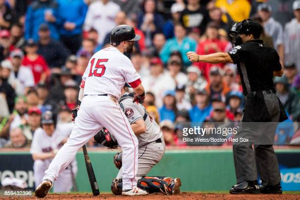 Dustin Pedroia of the Boston Red Sox argues with home plate umpire Mark Wegner during the second inning of game four of the American League Division...