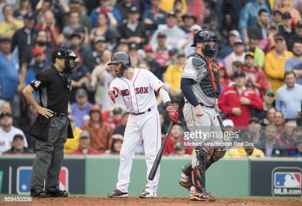 Dustin Pedroia of the Boston Red Sox argues with home plate umpire Mark Wegner after being called out on strikes against the Houston Astros in the...