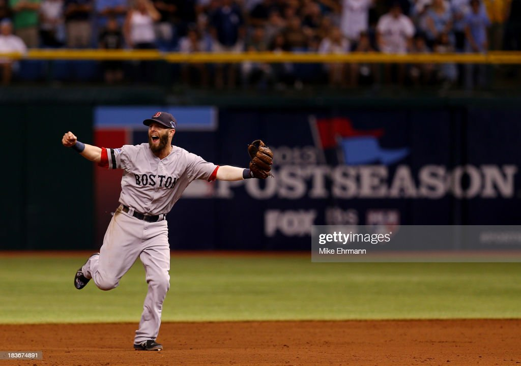 Dustin Pedroia #15 of the Boston Red Sox celebrates after defeating the Tampa Bay Rays 3-1 in Game Four of the American League Division Series at Tropicana Field on October 8, 2013 in St Petersburg, Florida.