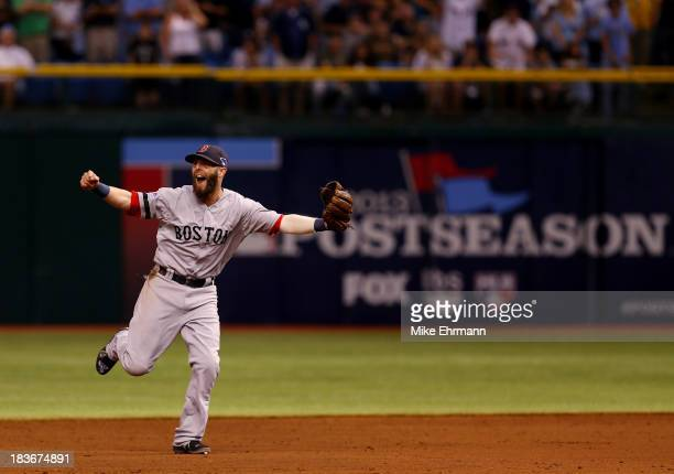 Dustin Pedroia of the Boston Red Sox celebrates after defeating the Tampa Bay Rays 3-1 in Game Four of the American League Division Series at...