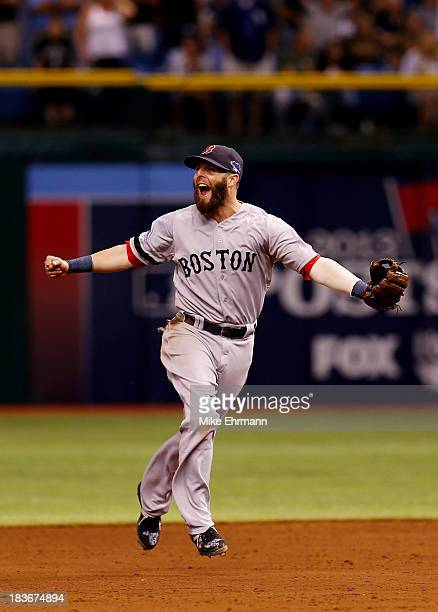Dustin Pedroia of the Boston Red Sox celebrates after defeating the Tampa Bay Rays 31 in Game Four of the American League Division Series at...
