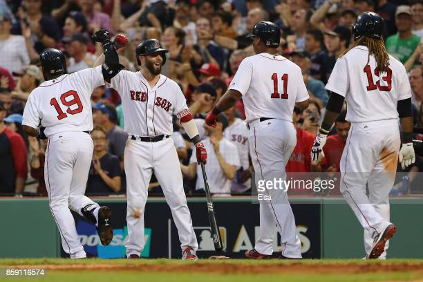 Dustin Pedroia of the Boston Red Sox celebrates after Jackie Bradley Jr #19 hit a threerun home run in the seventh inning against the Houston Astros...
