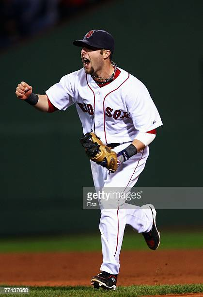 Dustin Pedroia of the Boston Red Sox celebrates after turning an inning double play against the Cleveland Indians in the seventh inning of Game Seven...