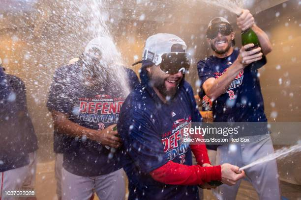 Dustin Pedroia of the Boston Red Sox celebrates in the clubhouse after clinching the American League East division following a victory against the...