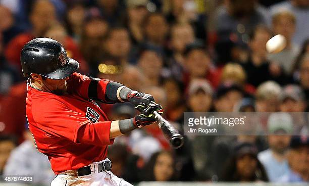 Dustin Pedroia of the Boston Red Sox connects for a grand slam home run in the sixth inning against the Oakland Athletics at Fenway Park on May 2...