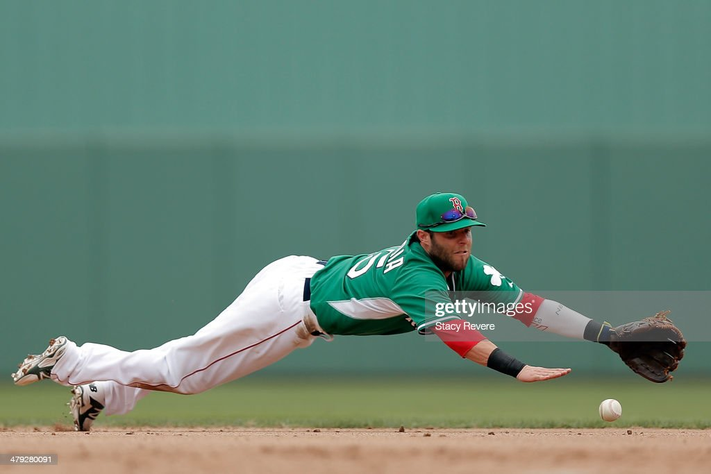 Dustin Pedroia #15 of the Boston Red Sox dives for a ball in the fourth inning of a game against the St. Louis Cardinals at JetBlue Park at Fenway South on March 17, 2014 in Fort Myers, Florida.