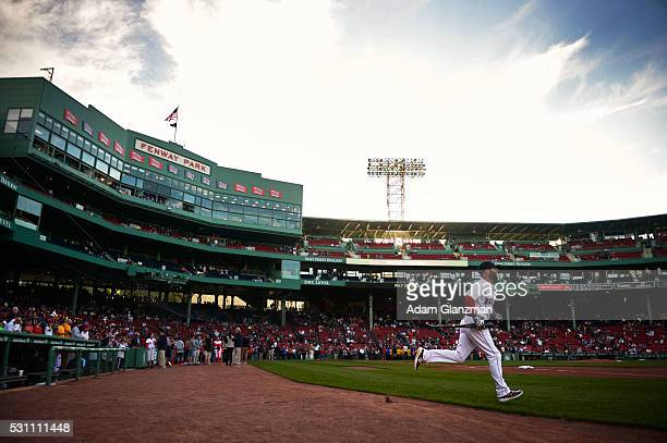 Dustin Pedroia of the Boston Red Sox enters the field before the game against the Oakland Athletics at Fenway Park on May 10 2016 in Boston...