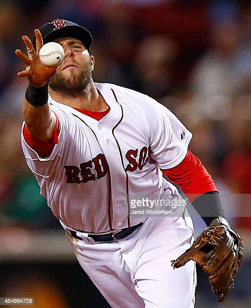 Dustin Pedroia of the Boston Red Sox flips the ball to second base after fielding a ground ball against the Baltimore Orioles during the game at...