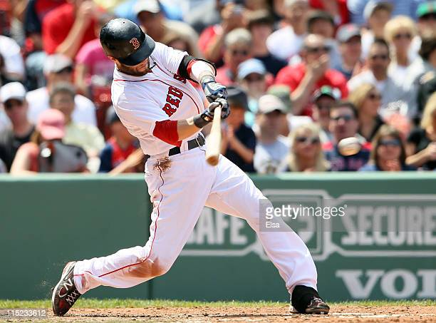 Dustin Pedroia of the Boston Red Sox gets an RBI single against the Oakland Athletics on June 4 2011 at Fenway Park in Boston Massachusetts