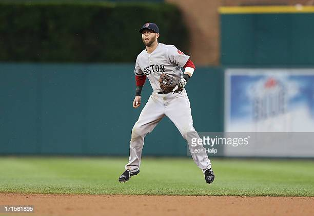 Dustin Pedroia of the Boston Red Sox gets ready to make the play with a quick hop during the fifth inning of the game against the Detroit Tigers at...