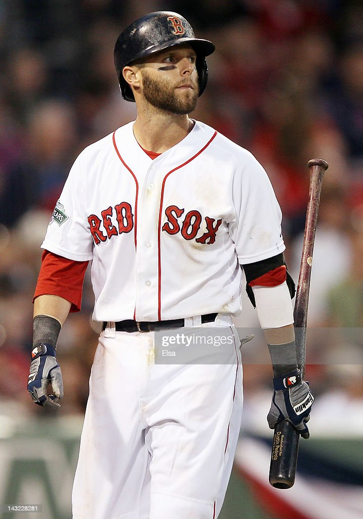 Dustin Pedroia #15 of the Boston Red Sox heads back to the dugout after striking out in the ninth inning against the New York Yankees on April 21, 2012 at Fenway Park in Boston, Massachusetts. The New York Yankees defeated the Boston Red Sox 15-9.