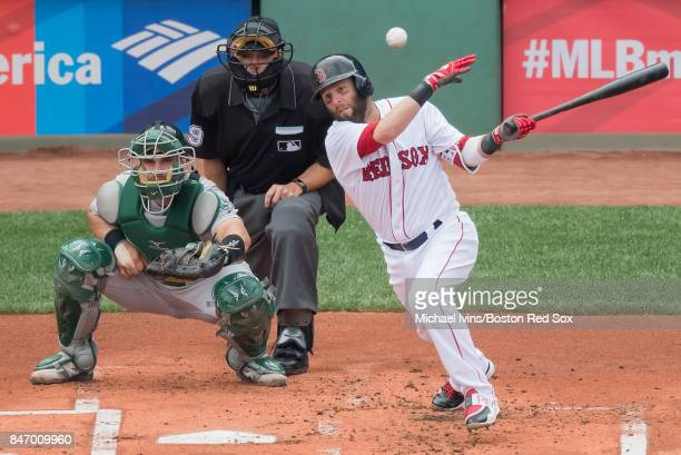 Dustin Pedroia of the Boston Red Sox hits a ground ball against the Oakland Athletics in the first inning at Fenway Park on September 14 2017 in...