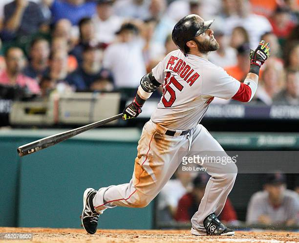 Dustin Pedroia of the Boston Red Sox hits a sacrifice fly in the seventh inning against the Houston Astros at Minute Maid Park on July 12 2014 in...
