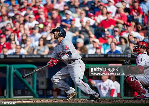 Dustin Pedroia of the Boston Red Sox hits a solo home run during the fifth inning against the Philadelphia Phillies in Philadelphia, Pennsylvania on...