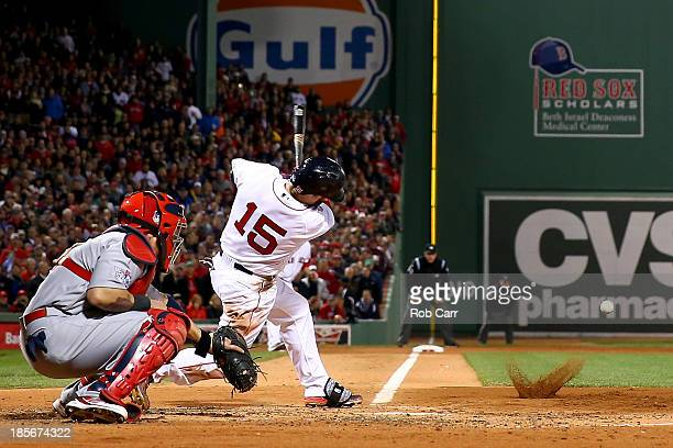 Dustin Pedroia of the Boston Red Sox hits an RBI single in the second inning against the St Louis Cardinals during Game One of the 2013 World Series...