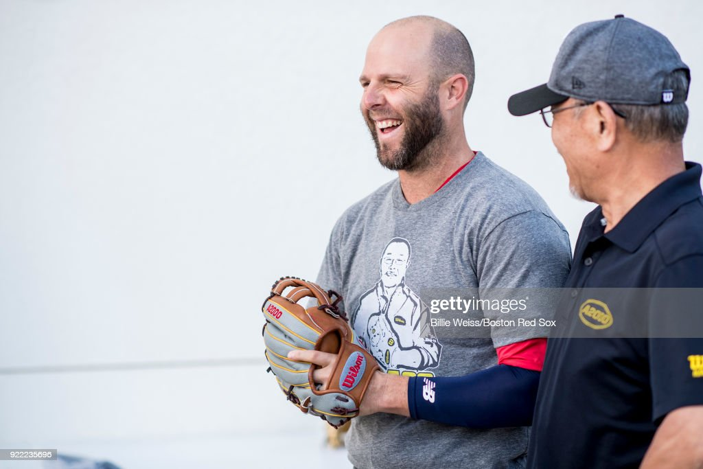 Dustin Pedroia #15 of the Boston Red Sox holds a Wilson glove during a team workout on February 21, 2018 at jetBlue Park at Fenway South in Fort Myers, Florida .