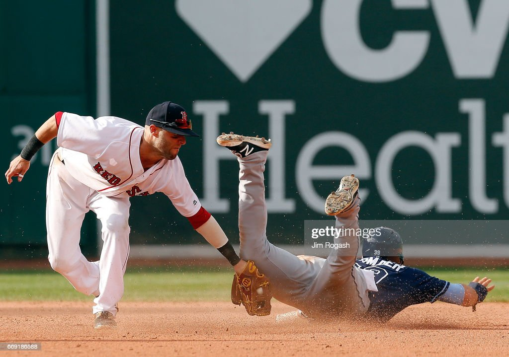 Dustin Pedroia #15 of the Boston Red Sox is late with the tag as Kevin Kiermaier #39 of the Tampa Bay Rays steals second base in the eighth inning against at Fenway Park on April 16, 2017 in Boston, Massachusetts.
