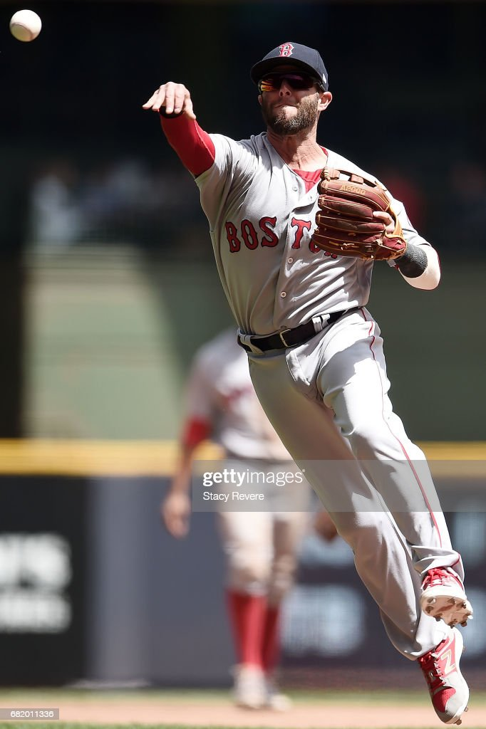 Dustin Pedroia #15 of the Boston Red Sox makes a throw to first base during the fourth inning of a game against the Milwaukee Brewers at Miller Park on May 11, 2017 in Milwaukee, Wisconsin.