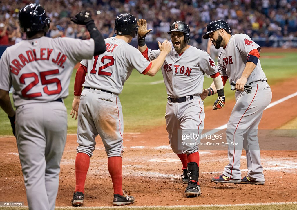 Dustin Pedroia #15 of the Boston Red Sox reacts after a grand slam against the Tampa Bay Rays in the seventh inning on September 24, 2016 at Tropicana Field in St. Petersburg, Florida.