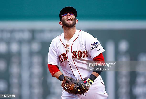 Dustin Pedroia of the Boston Red Sox reacts after failing to throw out a member of the Milwaukee Brewers out at first base during the Opening Day...