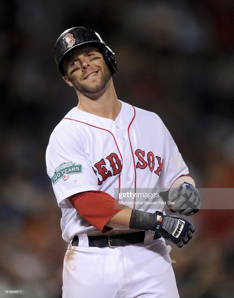 Dustin Pedroia #15 of the Boston Red Sox reacts after grounding out with the bases loaded against the New York Yankees in the seventh inning on September 11, 2012 at Fenway Park in Boston, Massachusetts.