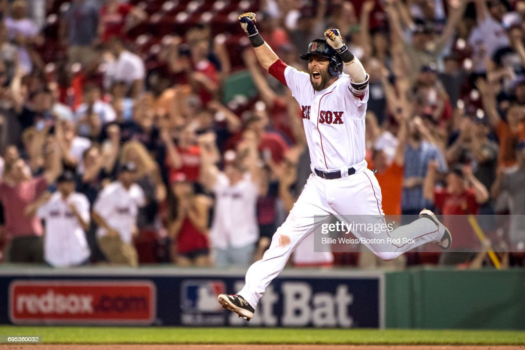 Dustin Pedroia #15 of the Boston Red Sox reacts after hitting a walk-off single during the eleventh inning of a game against the Philadelphia Phillies on June 12, 2017 at Fenway Park in Boston, Massachusetts.