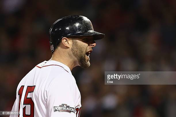 Dustin Pedroia of the Boston Red Sox reacts after striking out in the eighth inning against the Cleveland Indians during game three of the American...