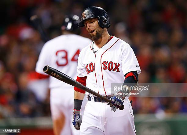 Dustin Pedroia of the Boston Red Sox reacts after striking out against the Cincinnati Reds during the interleague game at Fenway Park on May 7 2014...