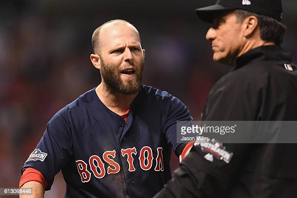 Dustin Pedroia of the Boston Red Sox reacts after striking out to end game one of the American League Divison Series against the Cleveland Indians at...