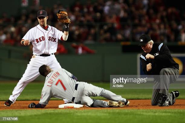 Dustin Pedroia of the Boston Red Sox reacts as second base umpire Brian Gorman calls Kenny Lofton of the Cleveland Indians out in the fifth inning of...