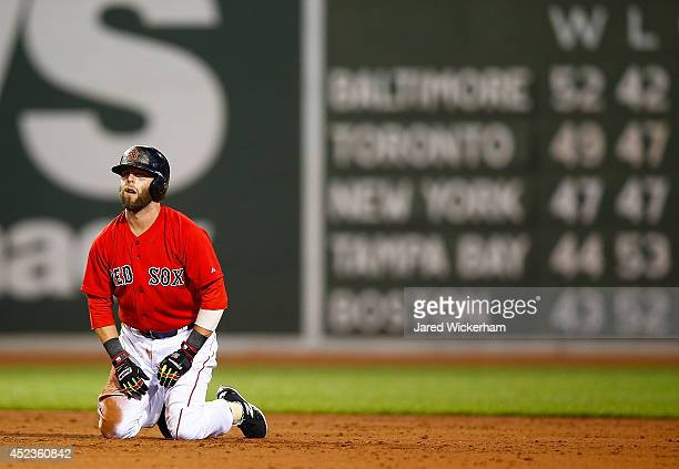 Dustin Pedroia of the Boston Red Sox reacts following a double play in the fifth inning against the Kansas City Royals during the game at Fenway Park...